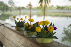 Banana leaf vessel for Loi Krathong Festival. 3 banana leaf vessels decorated with flower lay on the couch prepared for Loi Krathong festival in thailand Stock Photos