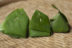 Banana Leaf Wrappings. Food packagings made from green banana leaf royalty free stock photos