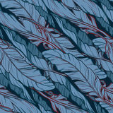 Banana leaves diagonal pattern on a dark blue background Royalty Free Stock Photography
