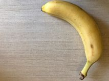 Banana on a light background with space for text. Banana on a light background royalty free stock photography