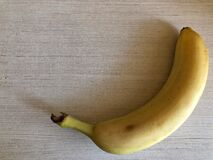 Banana on a light background with space for text. Banana on a light background royalty free stock image