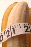 Banana macro with tape measure Royalty Free Stock Photos