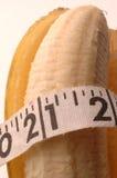 Banana macro with tape measure Royalty Free Stock Photos