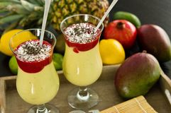 Banana and mango smoothie dessert in wine glasses Stock Photo