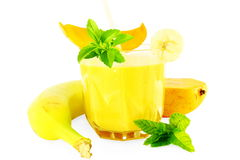 Banana mango smoothie with stevia and mint in pure white background Royalty Free Stock Photography