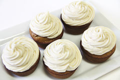 Banana Maple Cupcakes on top Stock Images