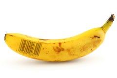 Banana matura con il codice a barre Fotografia Stock