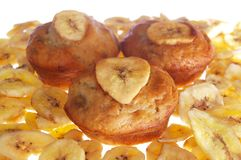 Banana mauffina on chips. Banana muffins laid out on a heap of chips isolated on white Stock Photo