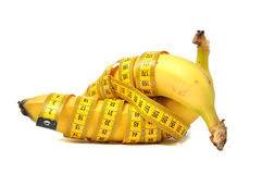 Banana and measure tape Royalty Free Stock Images