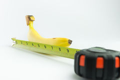 Banana and measuring tape Stock Photos