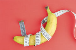 Banana With Measuring Tape Stock Images