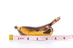 Banana and measuring tape Stock Photography