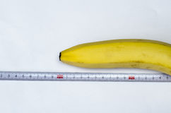 Banana and measuring tape Stock Images