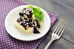 Banana with melted chocolate Stock Photography