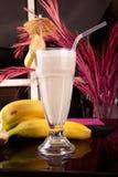 Banana juice. Fresh juice Milk with Banana with fresh banana fruits on restaurant background Stock Images