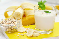 Banana milk shake with oat. Banana milk shake with fresh fruit and oat in a glass royalty free stock photos