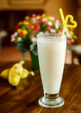 Banana milk shake on the wooden background Royalty Free Stock Images