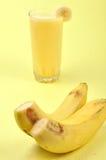 Banana milkshake. On yellow background Stock Photo