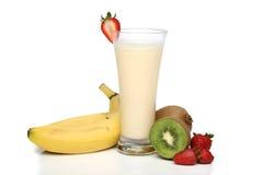 Banana milkshake with fruits Royalty Free Stock Images