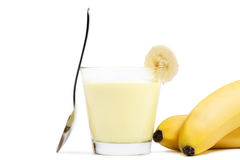 Banana milkshake with a piece of banana and spoon Stock Photo