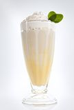 Banana milkshake. In a tall glass with fresh mint Royalty Free Stock Images