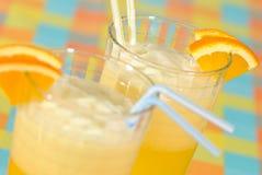 Banana Milkshakes. Two milkshakes, focus on drink to rear stock photos