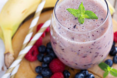 Banana and mixed berry smoothie Royalty Free Stock Photo