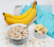Banana and muesli. On a old white wooden background Stock Images