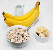 Banana and muesli. On a old white wooden background Royalty Free Stock Photos