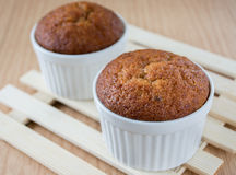 Banana muffin cake on wooden background Stock Photos