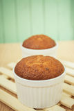Banana muffin cake on wooden background Royalty Free Stock Photos