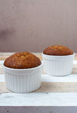 Banana muffin cake on wooden background Royalty Free Stock Images