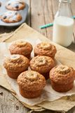 Banana muffin, side view, vertical. Cupcakes on old linen napkin, rustic wooden table, breakfast with cake and milk stock images
