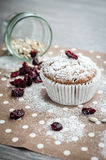 Banana muffin with sunflower seeds and dried cranberries on a napkin with polka dots Royalty Free Stock Photos