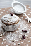 Banana muffin with sunflower seeds and dried cranberries on a napkin with polka dots Royalty Free Stock Image