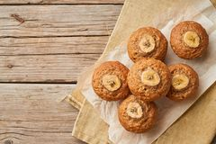 Banana muffin, top view, copy space. Cupcakes on old linen napkin, rustic wooden table, a breakfast with cake royalty free stock photos