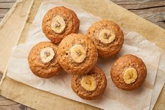 Banana muffin, top view. Cupcakes on old linen napkin, rustic wooden table, breakfast with cake stock photography
