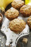 Banana muffins with oatmeal. Banana muffins with oat flakes on the table stock photos