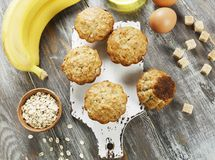Banana muffins with oatmeal. Banana muffins with oat flakes on the table stock images