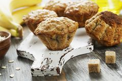 Banana muffins with oatmeal. Banana muffins with oat flakes on the table royalty free stock photography
