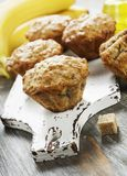 Banana muffins with oatmeal. Banana muffins with oat flakes on the table stock photo