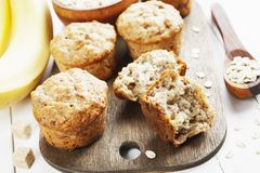 Banana muffins with oatmeal. Banana muffins with oat flakes on the table royalty free stock photo