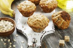 Banana muffins with oatmeal. Banana muffins with oat flakes on the table royalty free stock images