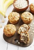 Banana muffins with oatmeal. Banana muffins with oat flakes on the table royalty free stock photos