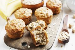 Banana muffins with oatmeal. Banana muffins with oat flakes on the table royalty free stock image