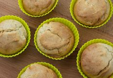 Banana muffins on a wooden background, top view royalty free stock photo