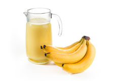 Banana nectar. In a carafe with a bunch of bananas on white background Stock Photos