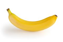 Banana no branco Fotos de Stock Royalty Free