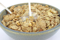 Banana and nut granola cereal with milk pouring Stock Image
