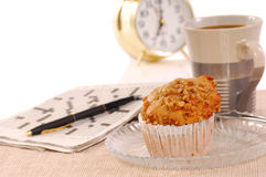 Banana nut muffin with alarm clock. Freshly baked banana nut muffin with coffee, alarm clock and crossword puzzle Royalty Free Stock Photos